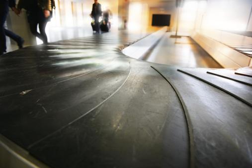 'Conveyour belt at airport, early morning'