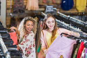 Young woman and teen in clothing store